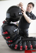 Inflatable rubber suit
